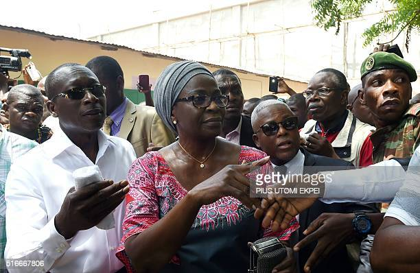 Cotton magnate and leader of coalition of the opposition Patrice Talon arrives with his wife Claudine to cast their ballot at Zongo polling station...