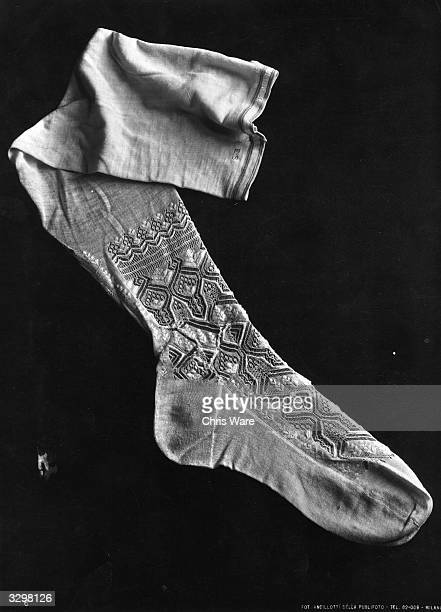A cotton stocking worn by Marie Antoinette queen of France with lace work around the ankle