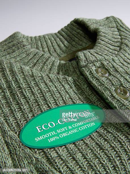 Cotton sweater with label, close-up