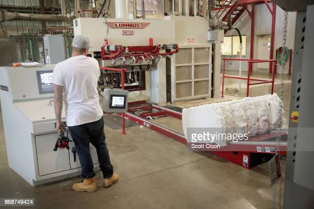 Cotton that has been cleaned of seeds and plant waste and dried is compressed into bales at Wilson Gin on October 30 2017 near Wilson Arkansas...