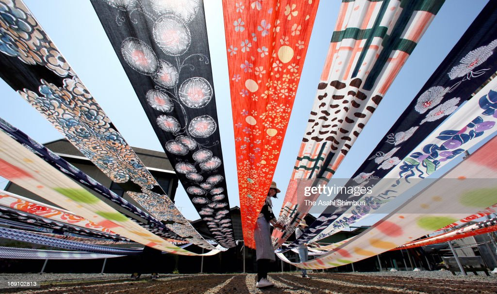 Cotton yukata fabric lay out to dry in the sun under blue sky as they enter the busy season at a dye house on May 14, 2013 in Utsunomiya, Tochigi, Japan.