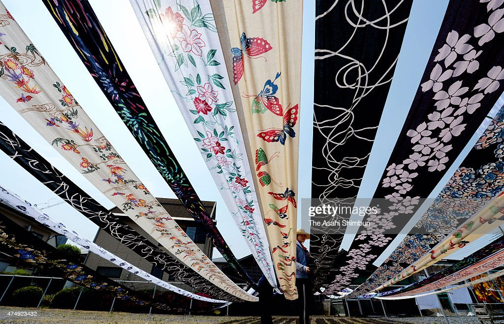 Cotton yukata fabric lay out to dry in the sun under blue sky as they enter the busy season at a dye house on May 28, 2015 in Utsunomiya, Tochigi, Japan. The factory uses the technique called 'Chusen', dying both side of fabric, to make the colors more vivid.