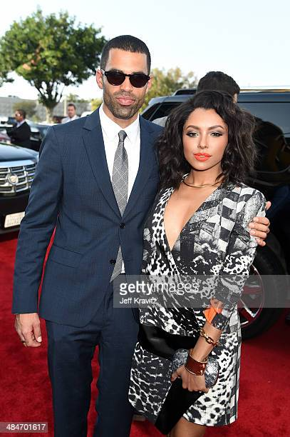 Cottrell Guidry and actress Kat Graham attend the 2014 MTV Movie Awards at Nokia Theatre LA Live on April 13 2014 in Los Angeles California