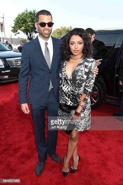 Cottrell Guidry and Cottrell Guidry and actress Kat Graham attend the 2014 MTV Movie Awards at Nokia Theatre LA Live on April 13 2014 in Los Angeles...