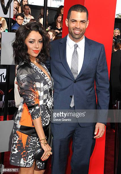 Cottrell Guidry and Kat Graham arrives at the 2014 MTV Movie Awards at Nokia Theatre LA Live on April 13 2014 in Los Angeles California