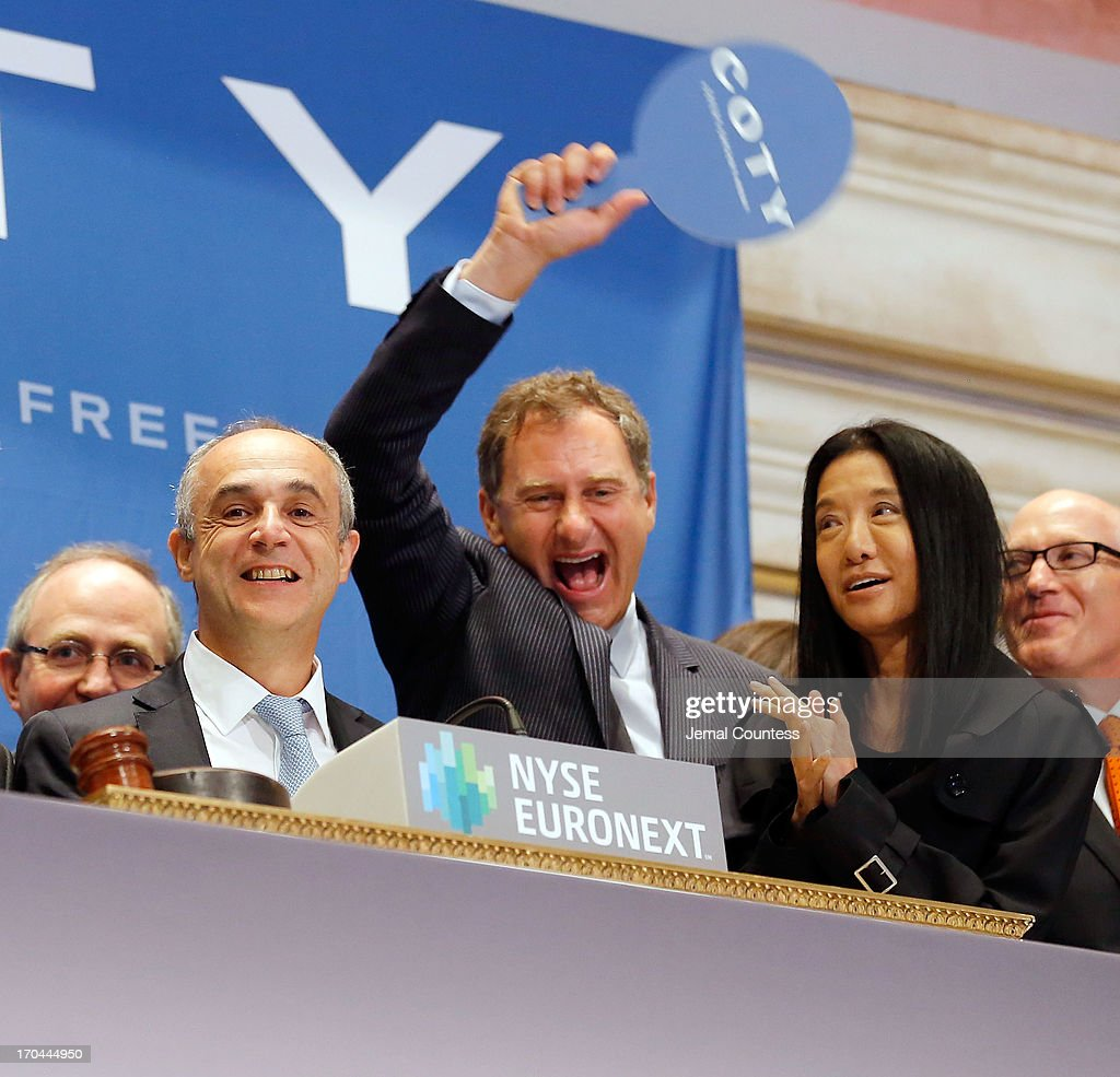 Coty CEO Michele Scannavini, President of Coty Prestige Jean Mortier, designer Vera Wang and Coty SVP Jules Kaufman ring the opening bell at the New York Stock Exchange on June 13, 2013 in New York City. Global beauty company Coty made its public debut today.