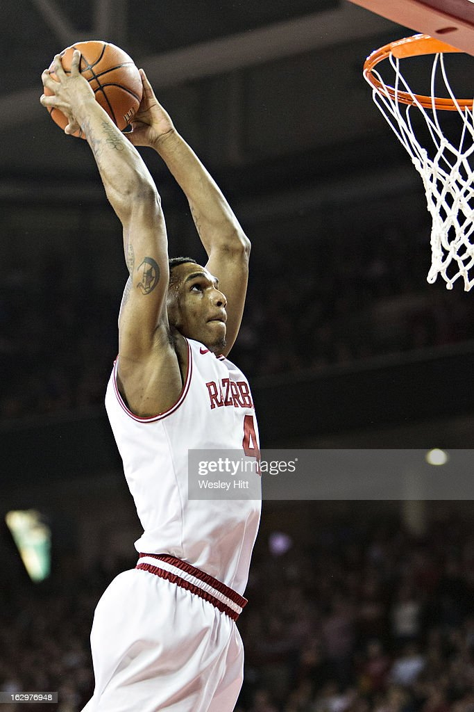 Coty Clarke #4 of the Arkansas Razorbacks goes up for a dunk against the Kentucky Wildcats at Bud Walton Arena on March 2, 2013 in Fayetteville, Arkansas. The Razorbacks defeated the Wildcats 73-60.
