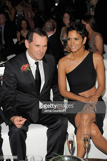 Coty Inc CEO Bernd Beetz and Halle Berry attend the 2011 FiFi Awards at The Tent at Lincoln Center on May 25 2011 in New York City