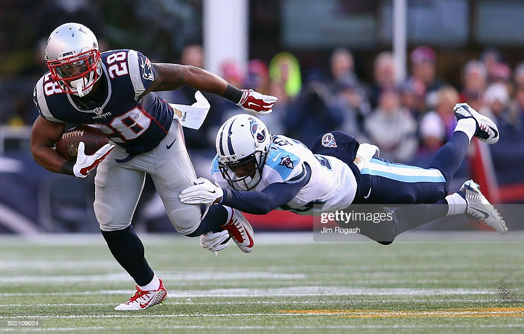 Coty Sensabaugh #24 of the Tennessee Titans attempts to tackle James White #28 of the New England Patriots during the first half at Gillette Stadium on December 20, 2015 in Foxboro, Massachusetts.