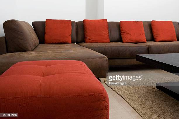 couch and ottomans in a living room - ottomane stockfoto's en -beelden