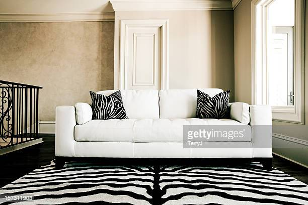 couch - animal pattern stock pictures, royalty-free photos & images