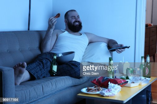 Couch Potato Man With Tv Remote Stock Photo Getty Images
