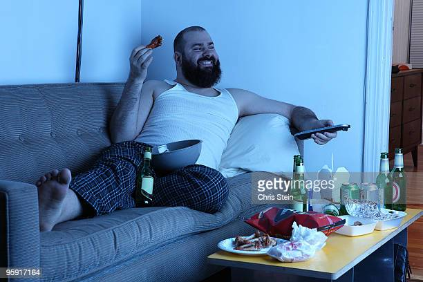 Couch Potato Man with  TV remote
