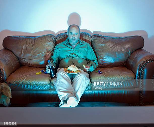 Obese Couch Potato Fat Guy Watching Tv St...