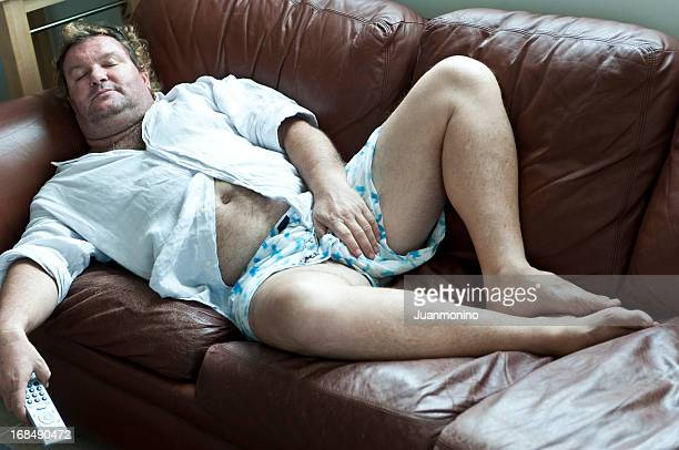 couch potato - chubby men stock photos and pictures