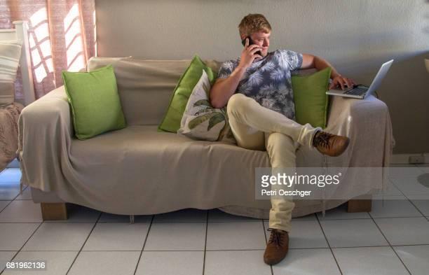couch potato. - 足を組む ストックフォトと画像