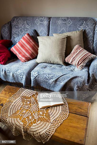 couch with cushions and doily on coffee table - doily ストックフォトと画像