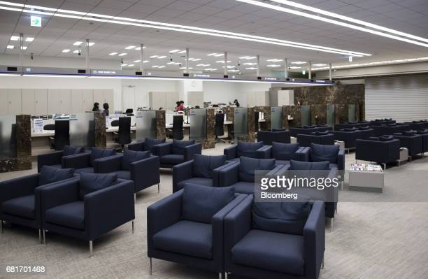 Couches sit at the Mizuho Bank Ltd branch inside the Mizuho Financial Group Inc headquarters in Tokyo Japan on Friday April 21 2017 Mizuho is...