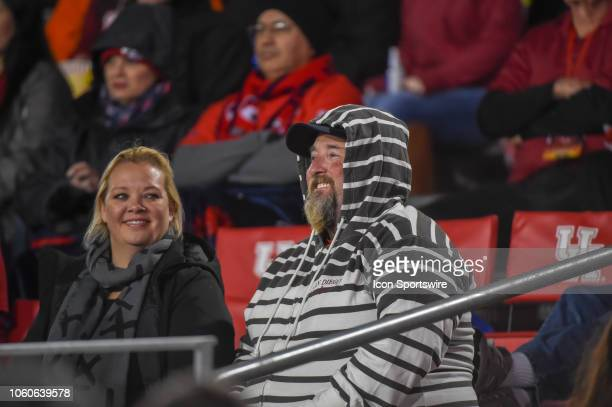 Cougar fans sit dressed for the cold weather during first half action during the football game between the Temple Owls and Houston Cougars on...