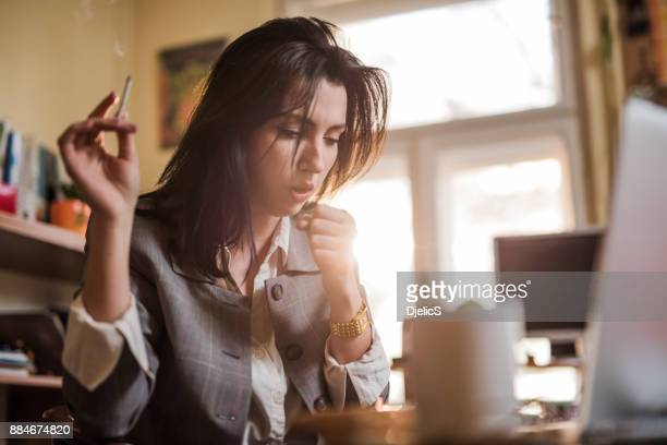 coughing from cigarettes. - cough stock pictures, royalty-free photos & images