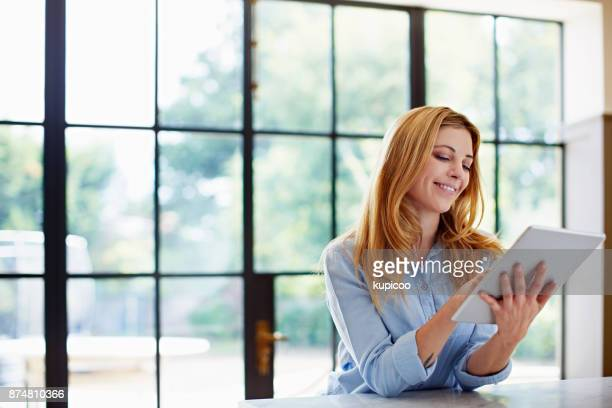 i could browse all day long - using digital tablet stock photos and pictures