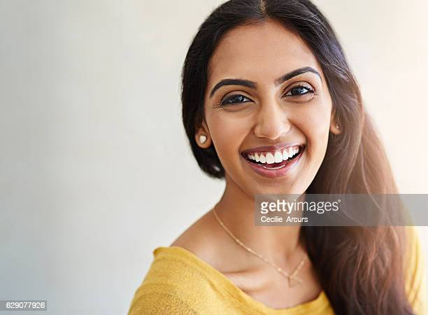 i couldn't be more happier with my life - indian woman stock photos and pictures