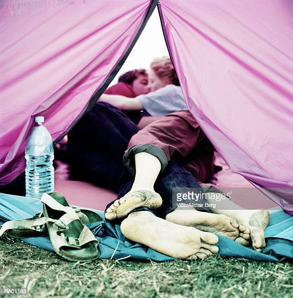 coule kissing in tent - festival goer stock pictures, royalty-free photos & images