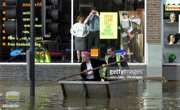 A council dory ferrying residents makes slow progress against the current flowing through the Frankwell area of Shrewsbury