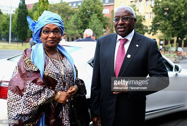 Council member and President of the IAAF Lamine Diack arrives with his wife Bintou Diack at the opening ceremony of the 47th IAAF Congress at the...