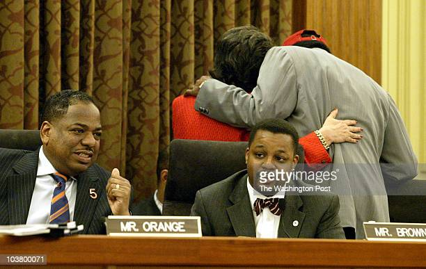 Council member Kwame Brown addresses the council as fellow member Vincent Orange listens with Carol Schwartz huddling with Marion Barry during...