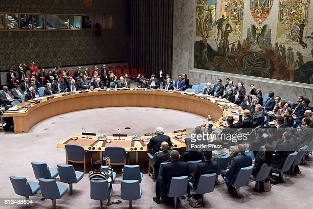 Council members in favor of the resolution raise their hands during the vote The United Nations Security Council convened an emergency meeting to...