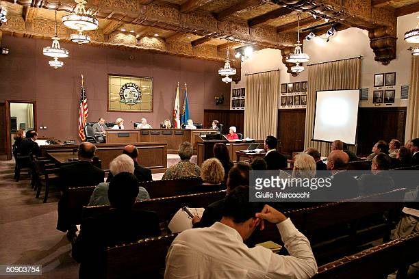 Council members meet to protest the proposed building permit for Michael Ovitz's 27000 square foot residence in Benedict Canyon at City Council...