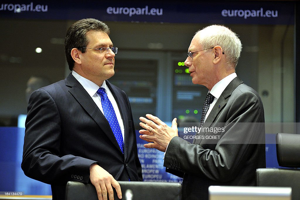 EU Council president Herman Van Rompuy and EU commissioner for Inter-Institutional Relations and Administration Maros Sefcovic (LtR) talk on March 20, 2013 prior a meeting with members of EU Parliament for the report of the last European Council at the EU Headquarters in Brussels. Parliament hosts a post-summit debate on EU economic policy with EP President Martin Schulz, political group leaders, European Council President Van Rompuy and Commission President Barroso. The EU's long-term budget is also likely to feature, ahead of negotiations to take place between Parliament and Council.