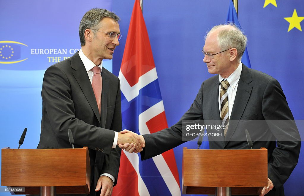 EU Council President Herman Van Rompuy (R) shakes hands with the Prime Minister of Norway Jens Stoltenberg during a joint press conference after their working session on June 16, 2010 at the EU headquarters in Brussels.