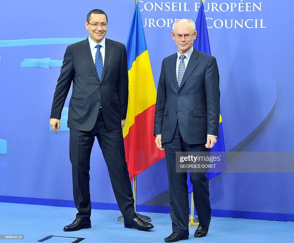 EU Council president Herman Van Rompuy (R) welcomes Prime Minister of Romania Victor Ponta (L) prior to their working session on February 4, 2013 at the EU Headquarters in Brussels. The EU and Romania have been at loggerheads for months over the assimilation of Bucharest into the bloc's political culture, but Ponta -- a former prosecutor -- said he had assured European Commission head Jose Manuel 'that Romania is right now a much more stable and predictable country ... a country which respects all the European standards.'