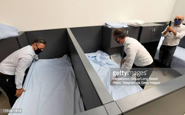 """Council President Pro-Tem Joe Buscaino and Los Angeles Mayor Eric Garcetti make beds as they officially opened the City""""u2019s 16th A Bridge Home..."""