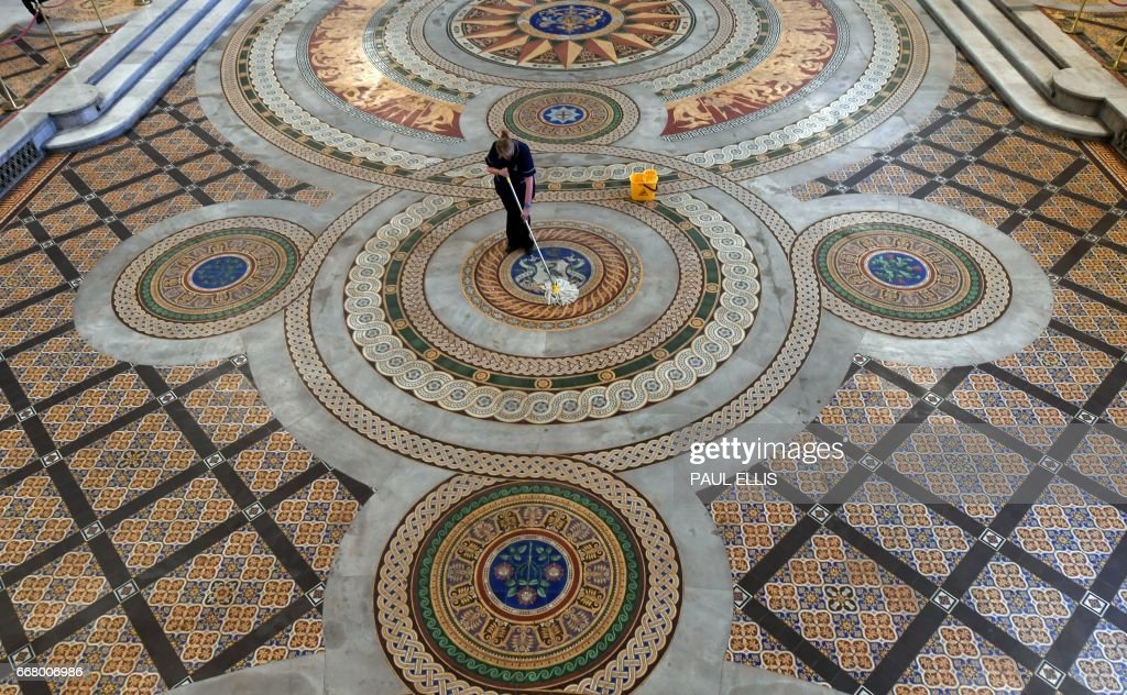 A Council Worker Cleans The Original Minton Tile Floor In A Rare