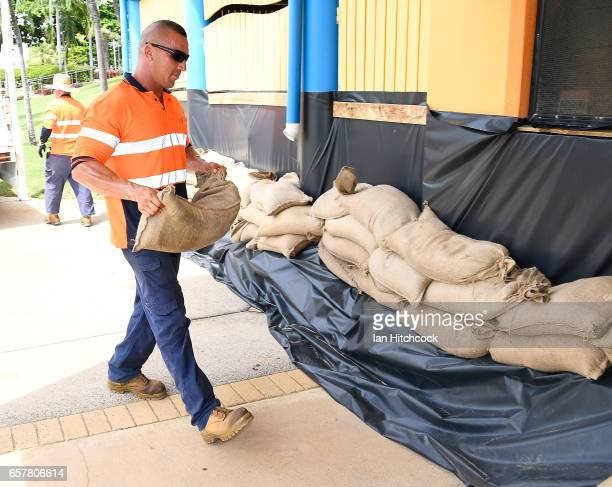 A council worker helps sandbag a Surf Lifesaving building along the Strand in preparation for Cyclone Debbie on March 26 2017 in Townsville Australia...