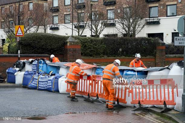 Council workers build a flood defence wall to protect houses next to the River Ouse as rain and recent melting snow begin to raise river levels on...