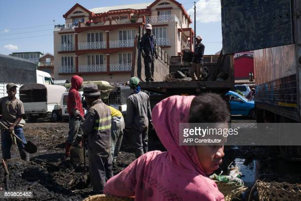 Council workers clear garbage during the cleanup of the market of Anosibe in the Anosibe district one of the most unsalubrious districts of...