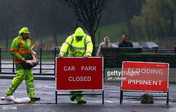 Council workers close a car park in Dumfries as a high risk of flooding is forecast on November 19, 2009 in Dumfries, Scotland. Much of south west...