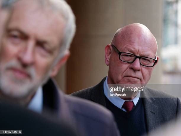 Councillor Mick Thompson listens as Labour leader Jeremy Corbyn speaks to media as he visits Middlesbrough Centre Square on January 25 2019 in...