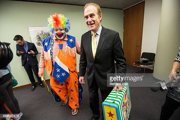 Councillor Norm Kelly brings Doo Doo the clown into his office for a private chat after congratulating him for rescuing two women on Sunday from an...