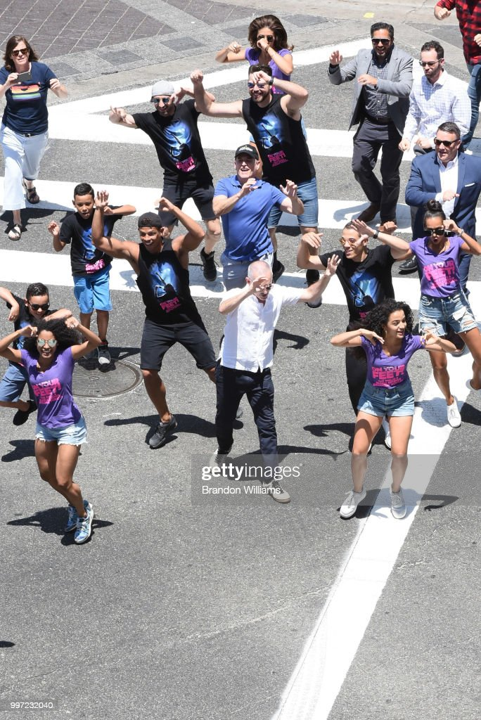 Councilman Mitch O'Farrell (center, white shirt) dances with the cast of 'On Your Feet' during the dedication ceremony of the scramble crosswalk on Hollywood and Vine on July 12, 2018 in Hollywood, California.