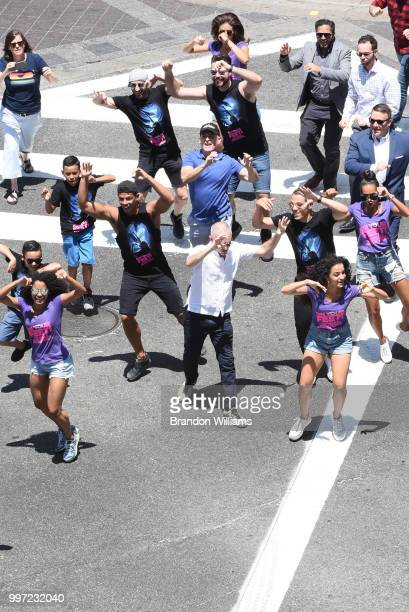 Councilman Mitch O'Farrell dances with the cast of 'On Your Feet' during the dedication ceremony of the scramble crosswalk on Hollywood and Vine on...