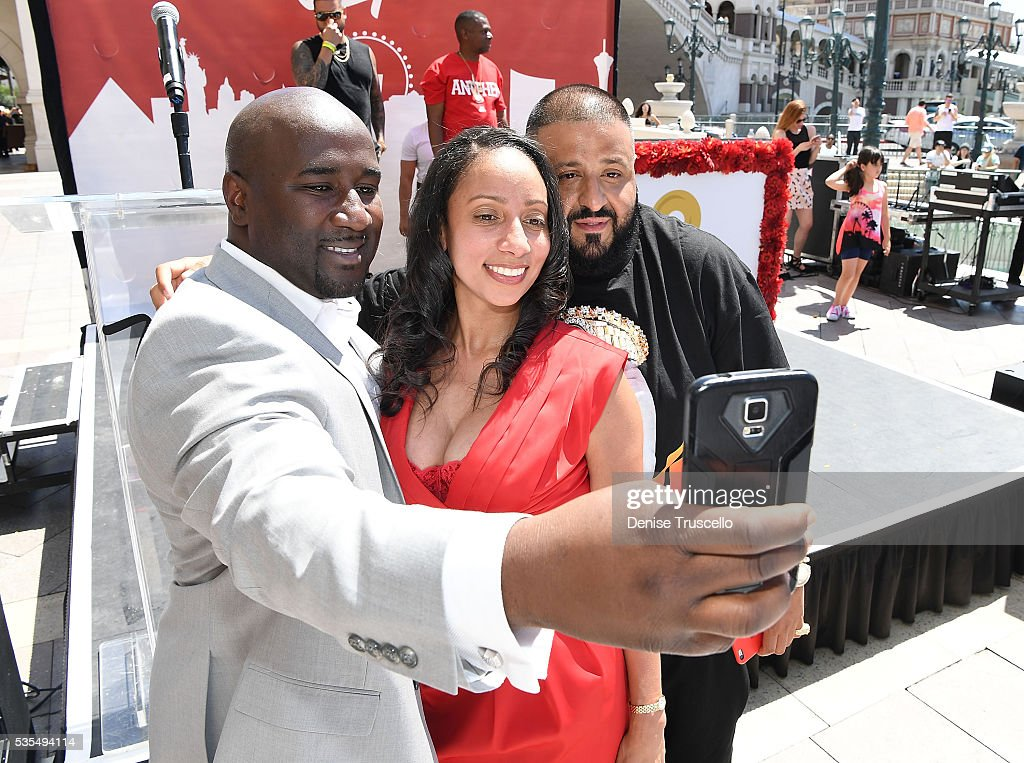 Councilman Ricki Barlow (L) and DJ Khaled (R) pose for selfies during the ceremony presenting DJ Khaled a key to the Las Vegas strip and the launch of official snapchat channel at the Venetian Hotel and Casino on May 29, 2016 in Las Vegas, Nevada.