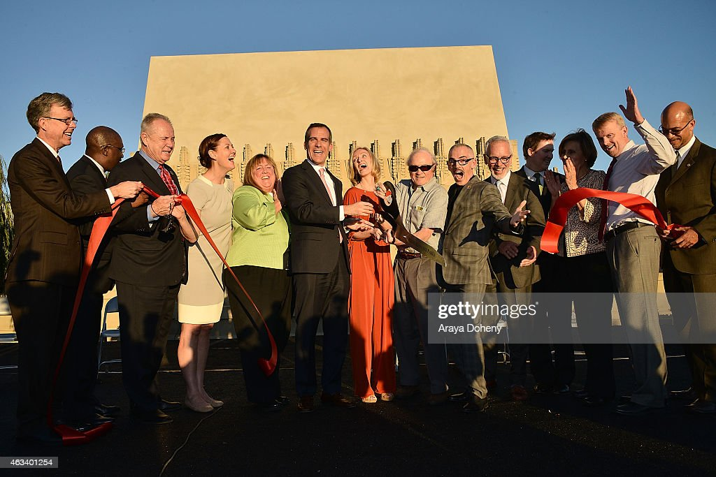 Councilman Tom Labonge, Linda Dishman, Mayor Eric Garcetti, Kate Devine Brady, Councilmember Mitch O'Farrell and Jeffrey Herr attend the ribbon-cutting ceremony for the re-opening of The Frank Lloyd Wright Hollyhock House on February 13, 2015 in Los Angeles, California.