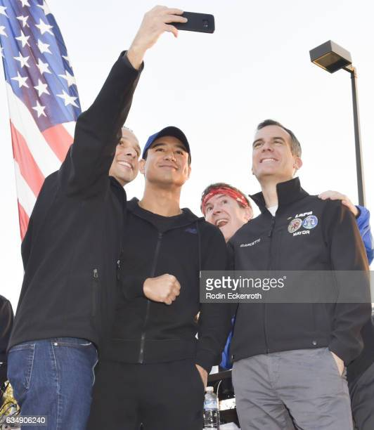 Councilmember Mitchell Englander TV host Mario Lopez and LA Mayor Eric Garcetti are photobombed during selfie onstage at 2nd Annual Run To Remember...