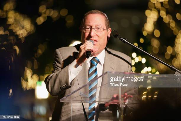 Councilmember Paul Koretz speaks onstage at the Village Synagogue and Emmanuelle Chriqui Host Menorah Lighting Ceremony at The Grove on December 12...