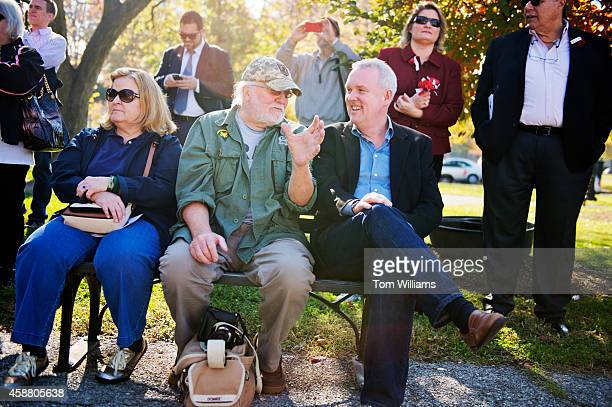 C Councilmember Tommy Wells right talks with Army veteran Philip Yunger during a Veteran's Day ceremony in Folger Park on Capitol Hill hosted by the...
